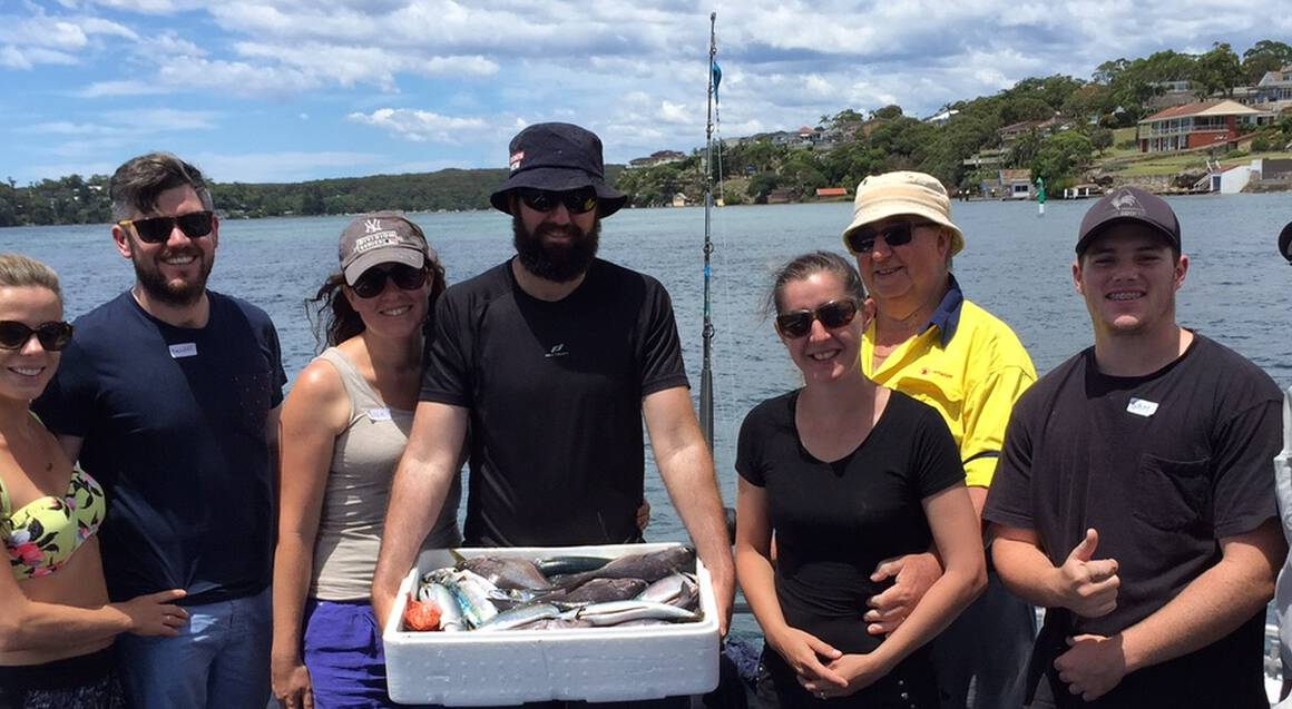 All At Sea Solutions Port Hacking Fishing trip group posing with fish in esky