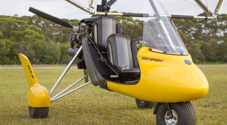 gyrocopter close up of front seats and wheels with no one in it