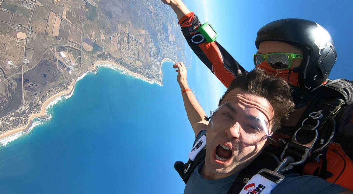 man and instructor tandem skydiving over great ocean road