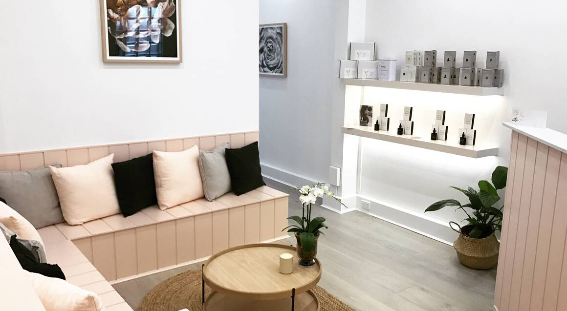 pregnancy massage day spa waiting area with seating table and counter