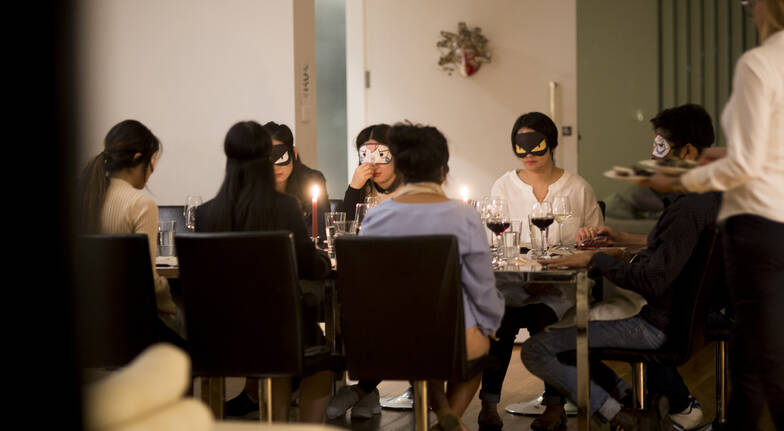 Chefin private chef dinner at home guests eating dinner blindfolded
