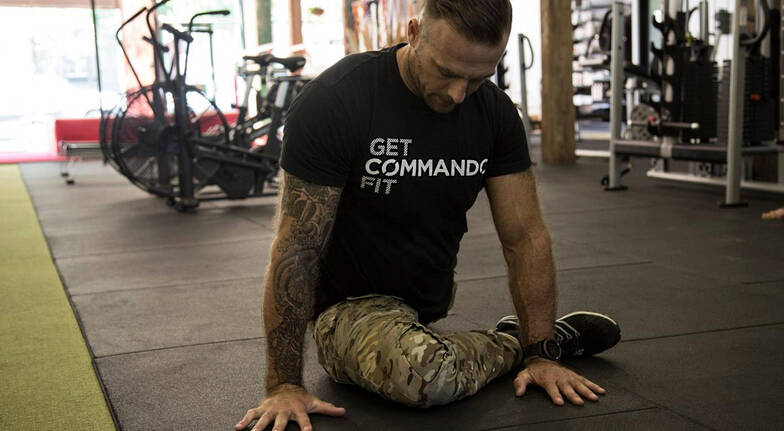 Commando steve personal trainer biggest loser stretching in gym