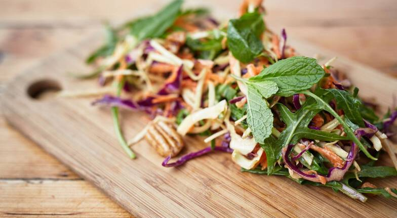 tapas lunch close up of coleslaw on a wooden board
