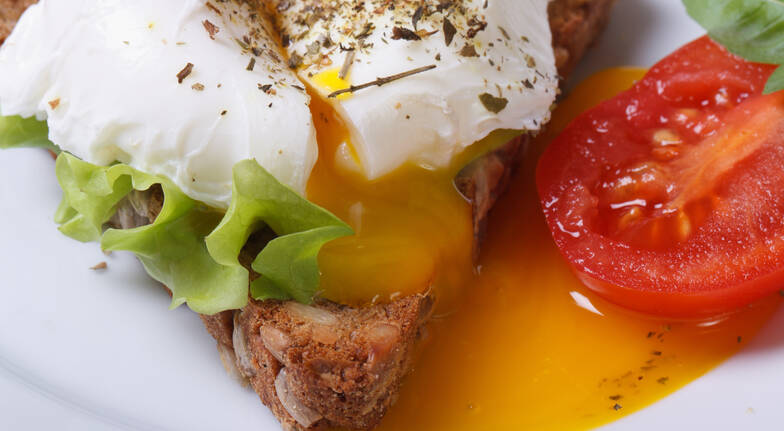 poached egg on toast with tomato and lettuce
