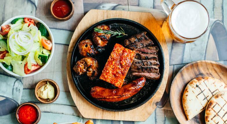 rump steak chicken pork belly and sausage plate