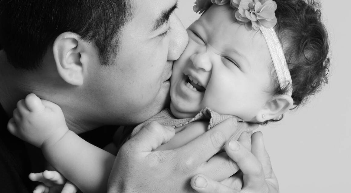 father and baby girl posing for professional photos
