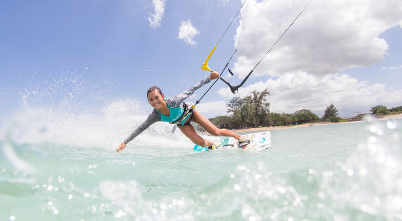 woman kiteboarding in ocean sunshine coast