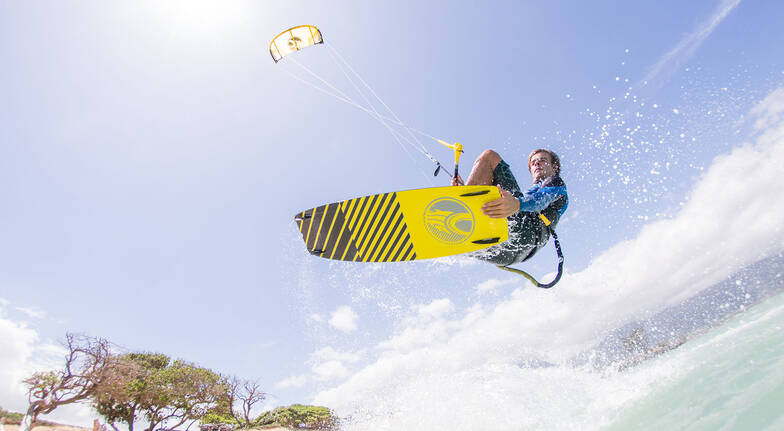 man kiteboarding in ocean sunshine coast