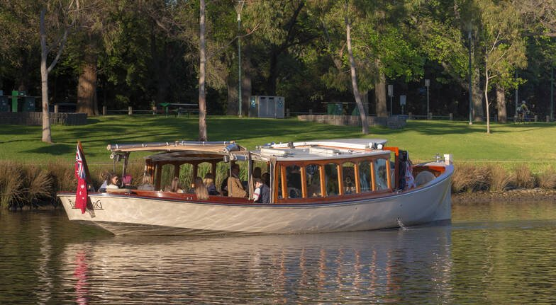 boat cruising past melbourne city park