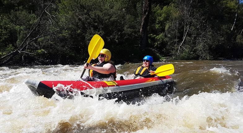 two people paddling through white water rapids on yarra river