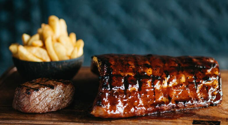 Steakhouse Dining Experience with Bottle of Wine  For 2