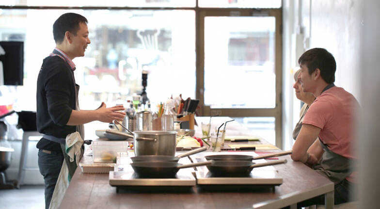 otao kitchen chef doing cooking demonstration with couple