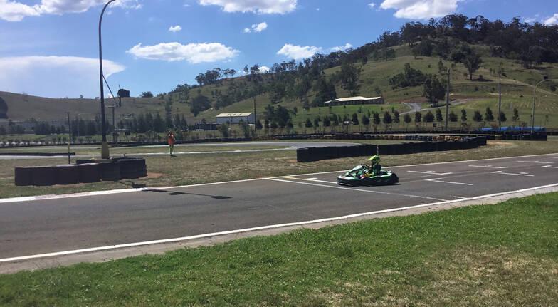 boy driving go kart on track picton