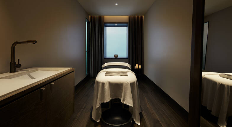 canberra hotel dimly light day spa room with day spa massage table