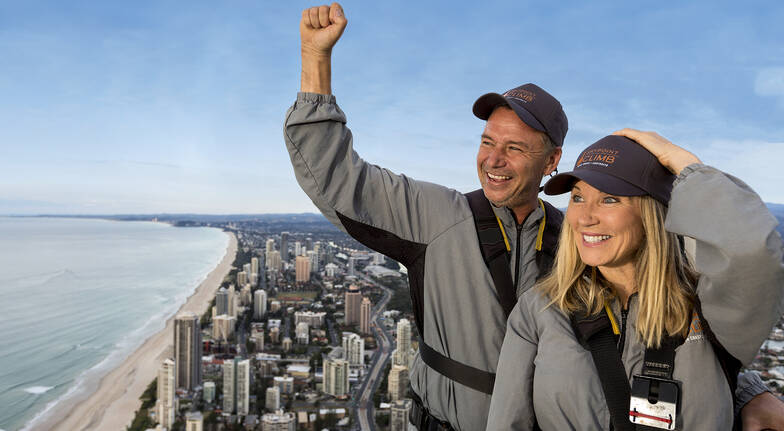 couple climbing Q1 tower with view of gold coast