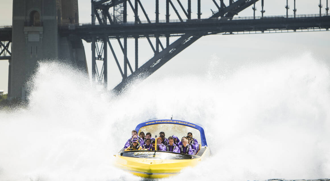Thunder Jet Boat group riding on sydney harbour passing harbour bridge