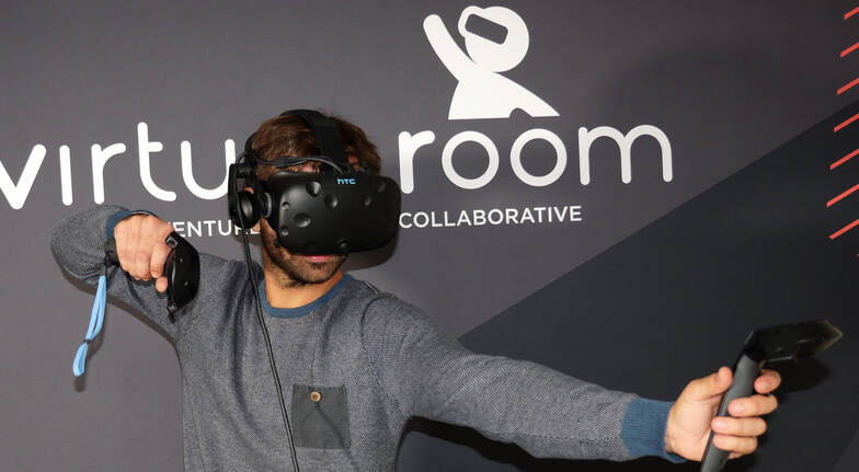 Man playing virtual reality game with headset