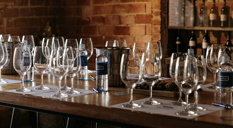 glasses of wine on table set up for wine tasting