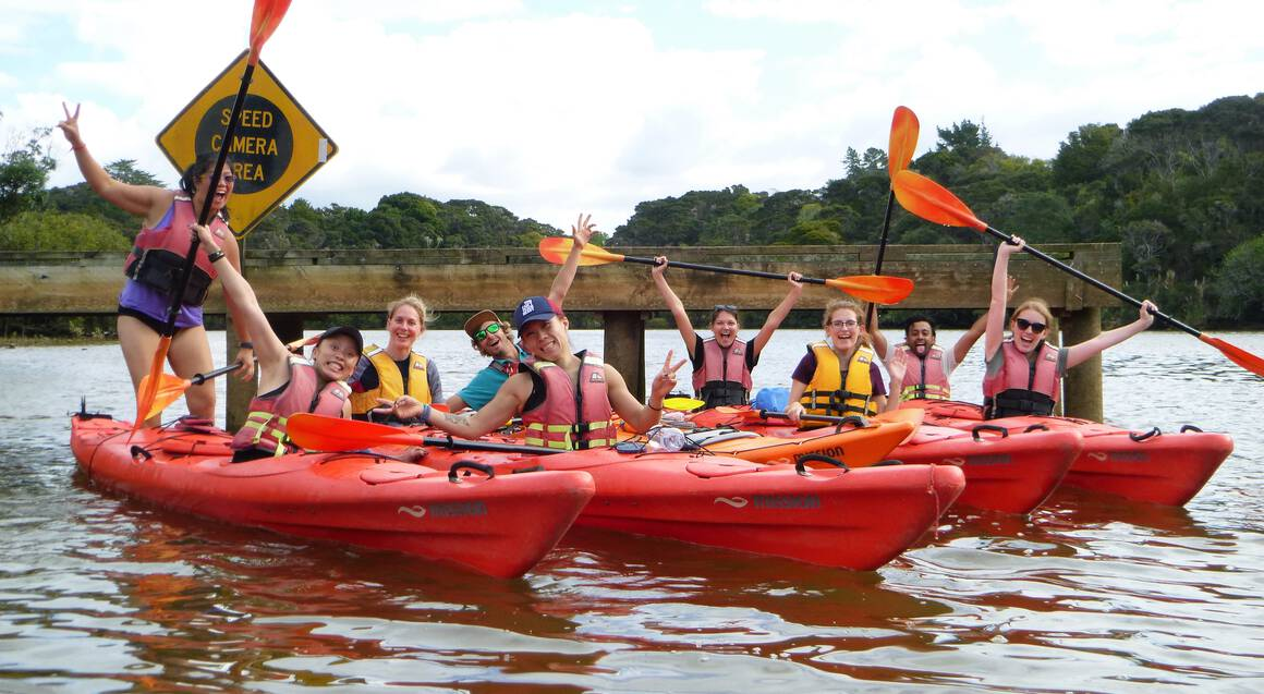 Group of kayaks with people celebrating