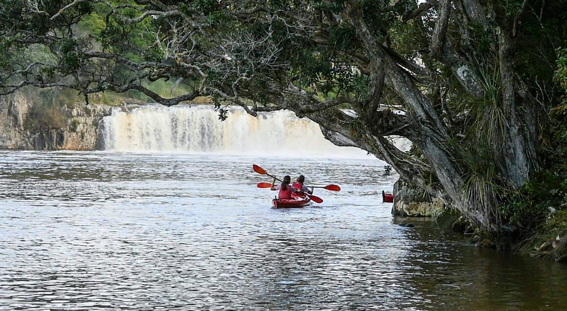 Two kayaks paddling down waitangi inlet