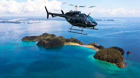 Helicopter Flight over Bay of Islands to Hole in The Rock