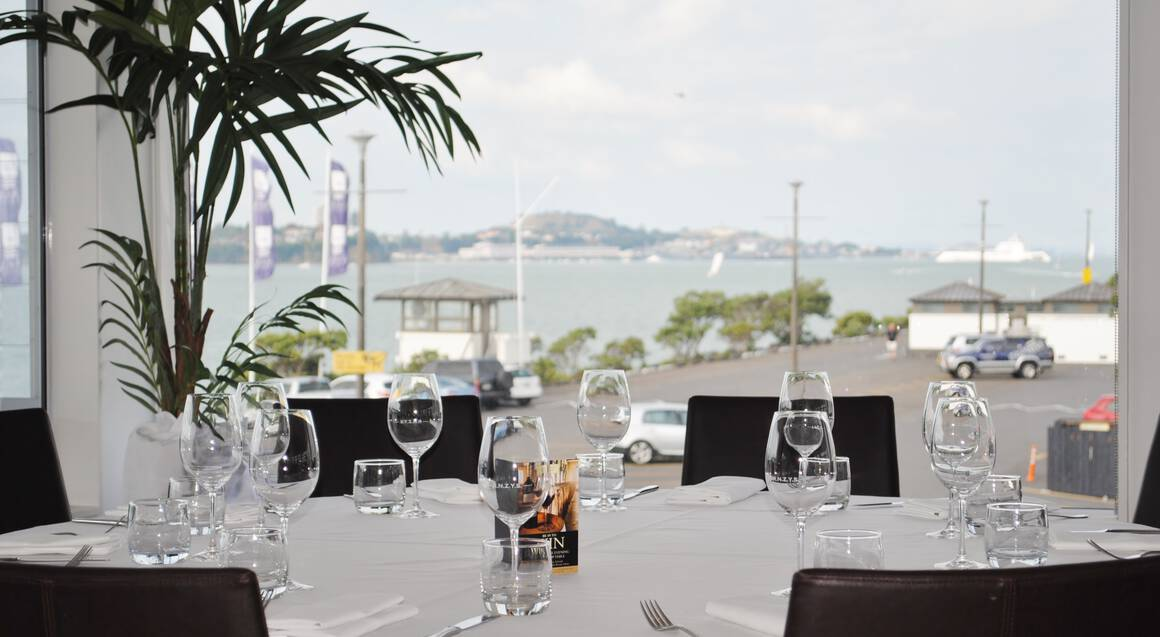 dinner table with wine glasses on auckland harbour